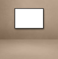 Black picture frame hanging on a beige wall