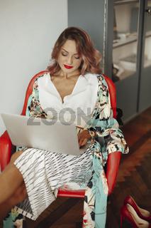 Elegant woman using laptop at home