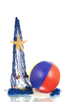 Blue fishing net with shells and beach ball
