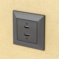 Black wall socket with USB ports