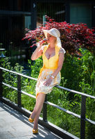 Woman in dirndl drinks from champagne