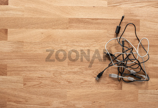 USB cables on a wooden table