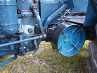 Belt drive wheel on a tractor