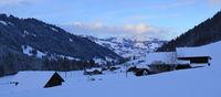 Saanenland valley on a winter evening.