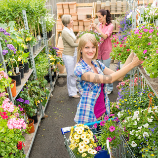 Woman shopping for flowers in garden shop