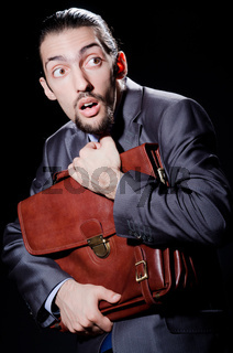 Business spy with briefcase
