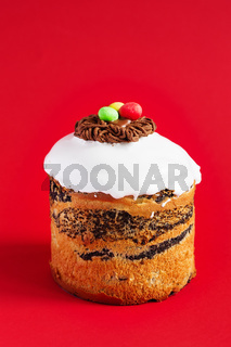 Easter Cake - Russian and Ukrainian Traditional Kulich on a bright red background. Paska Easter Bread. Happy easter. Kulich cake symbol of Traditional Orthodox Easter