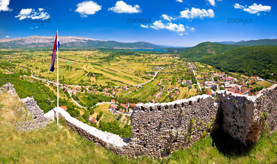 Town of Vrlika and Peruca lake aerial panoramic view from Prozor fortress