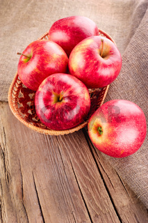 Ripe apple fruits on old wooden table