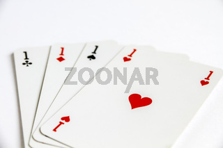 Four aces playing card game on white background