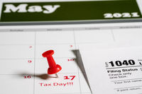 Tax Day concept for May 17 2021 using calendar and note