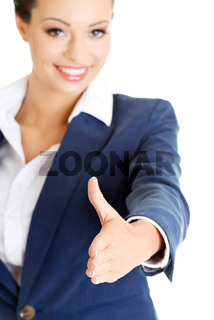 A beautiful businesswoman about to shake hands.