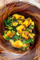 Indian saag aloo, potato and greens curry dish