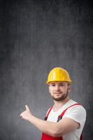Worker pointing his finger at the wall