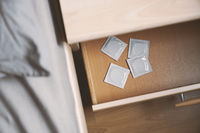 condoms in bedside table or nightstand drawer