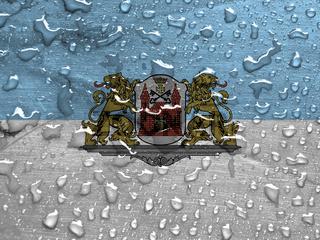 flag of Riga, Latvia with rain drops