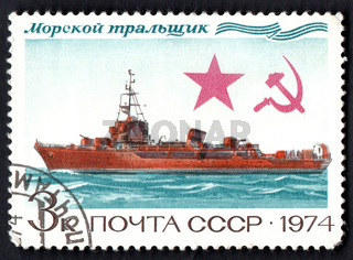 Postage stamp dedicated to sea ship. Stamp with image of Soviet sea minesweeper