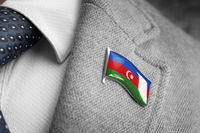 Metal badge with the flag of Azerbaijan on a suit lapel