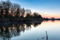 Sunrise at a small lake in Bavaria, Germany