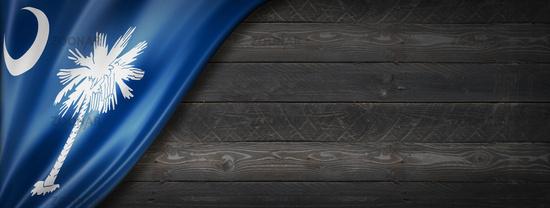 South Carolina flag on black wood wall banner, USA