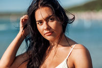 young woman in bikini swimsuit on beach