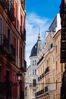 View of narrow street in historic centre of Madrid, Spain