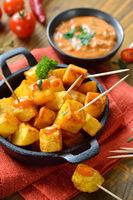Potatoes with hot chili sauce