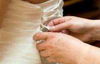 bride dress helping hand mother