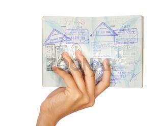 Hand showing passport, close-up shot
