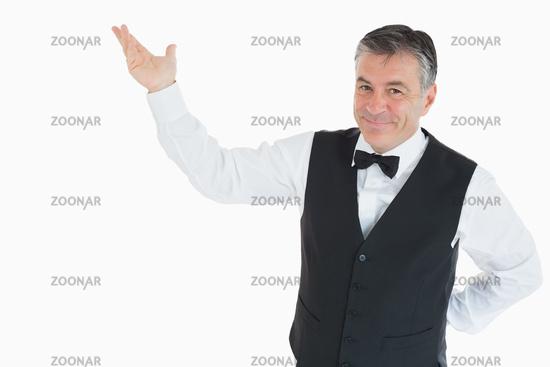 Smiling man pointing to something