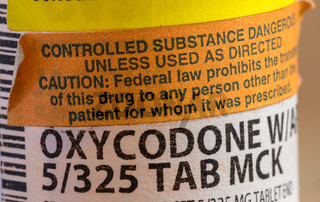 Oxycodone opioid tablets bottle and label in extreme close up for court battle in WV