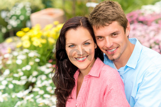 Happy couple embracing in nature garden
