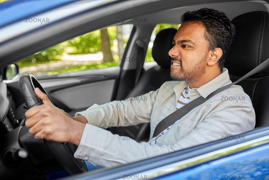angry indian man or driver driving car