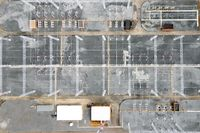 Aerial top view electric substation industry, View from above high voltage tower electricity, industrial infrastructure.