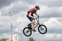 Belarus, Gomel, June 24, 2018. Central park. Extreme cycling.A high jump on the bike.Risky trick on the bike