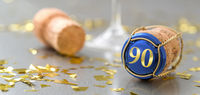 Champagne cap with the Number 90