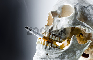 Skull with burning cigarette in mouth