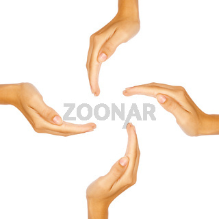 Four human hands forming a circle with copy-space in the middle