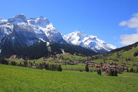 Village Gsteig bei Gstaad and snow covered mountains.