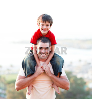 Father giving son piggyback ride