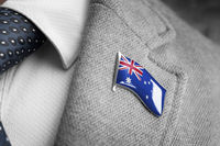 Metal badge with the flag of Australia on a suit lapel