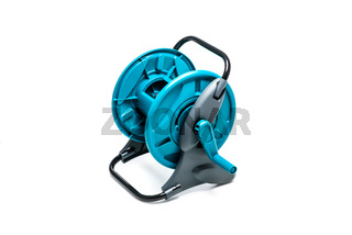 Plastic hose reel isolated on white background. Gardening tool for water supply and watering a garden or vegetable garden