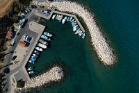 Aerial view of fishing boats and tourist yachts moored at the marina. Pomos harbor Paphos Cyprus