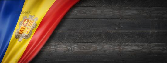 Andorran flag on black wood wall banner