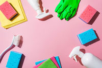 House cleaning product on pink background, copy space