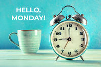 Hello, Monday Inspirational greeting card with a vintage alarm clock