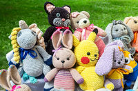 Various knitted soft toys outdoors