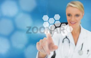 Blonde doctor using touchscreen displaying hologram