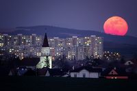 moonrise with church tower and houses in the background
