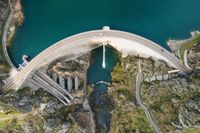 Aerial drone footage top view Water dam and reservoir lake, generating hydro electricity power renewable energy and sustainable development. High quality photo